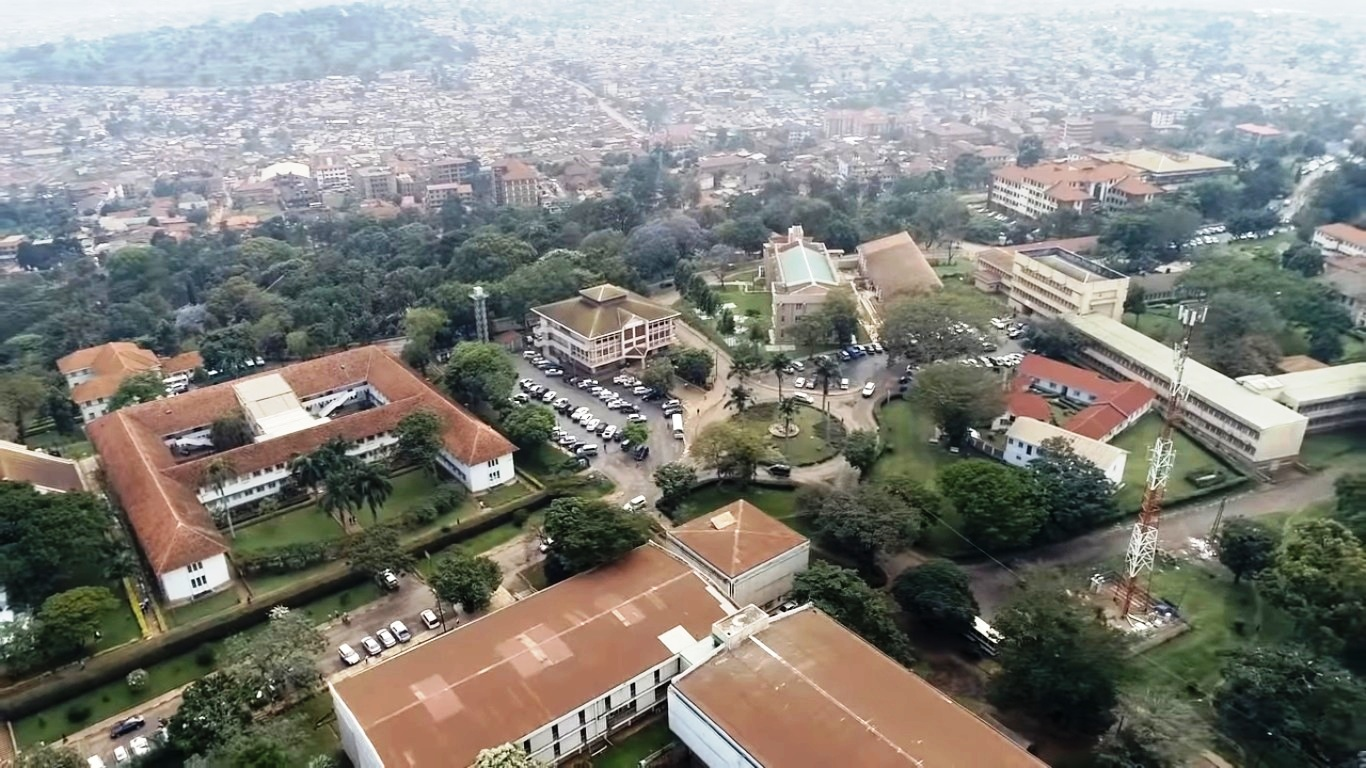 An aerial view of the Colleges of Natural Sciences-CoNAS, Agriculture-CAES, Engineering-CEDAT, School of Statistics, Departments of Chemistry and Mathematics. Partly visible in the background is the surrounding Kikoni neighbourhood, October 2018, Makerere University, Kampala Uganda