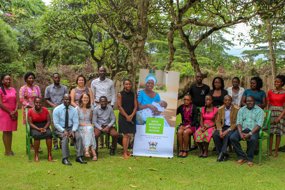 Dr. Phyllis Awor, Hub Director-Social Innovation in Health Initiative (Centre black dress) with SIHI Staff at the Makerere University School of Public Health, Kampala Uganda. Image:SIHI